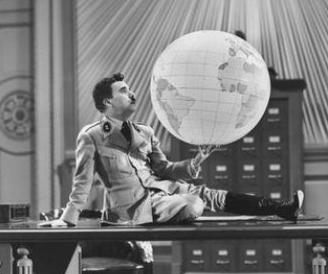Charlie Chaplin plays in The Great Dictator, holding a model of the earth.
